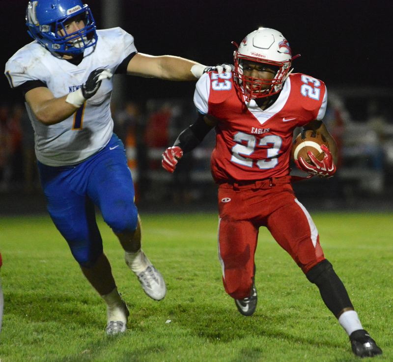 OUTLOOK PHOTO: DAVID BALL - Centennial running back Jimmie Barton eludes Newberg tackler Gage Wright during the Eagles 56-27 loss Friday night.