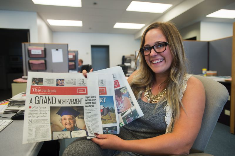 OUTLOOK PHOTO: JOSH KULLA - The Outlook's summer reporting intern, Clara Howell, shows off three front-page stories published during her prestigious Snowden fellowship in Gresham.