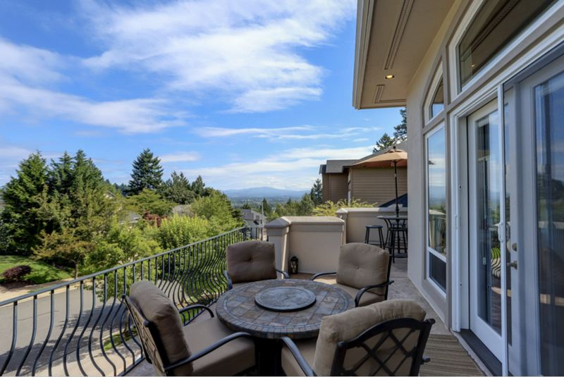 PHOTO COURTESY MICHAEL PATRICK - Soaring views of the east foothills are on full display from the stamped-concrete veranda of this three-level home in Gresham.