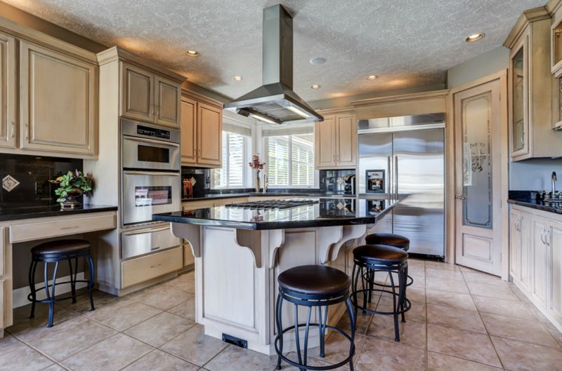 PHOTO COURTESY MICHAEL PATRICK - A luxurious six-burner gas range and 48-inch in-built refrigerator are two appliances in this spacious European-style kitchen suite.