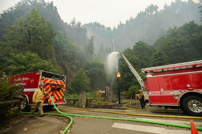 FILE PHOTO - Firefighters from Tualatin Valley fight the blaze.