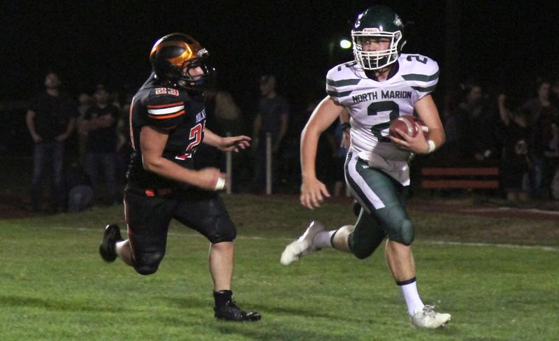 INDEPENDENT PHOTO: PHIL HAWKINS - North Marion senior Sam Garcia runs for a 36-yards touchdown against Molalla during his team's 22-6 win on Friday night.