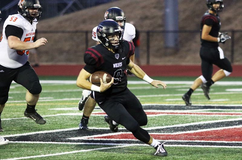TIMES PHOTO: DAN BROOD - Tualatin junior quarterback Kyle Dernedde takes off on a 41-yard run on a scramble during his team's 53-6 win over Battle Ground. Two plays later, Dernedde threw an 8-yard touchdown pass to senior receiver Chris Freese.