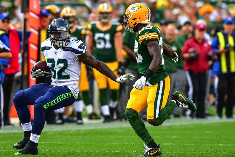 PHOTO BY MICHAEL WORKMAN - Seattle running back Chris Carson had 30 yards on a second-half carry but only 39 total against a stout Packers defense.