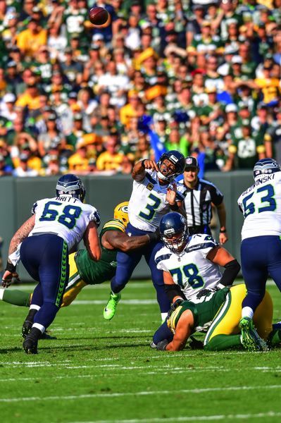 PHOTO BY MICHAEL WORKMAN - Russell Wilson passed for only 158 yards in the opening-day loss for the Seahawks.