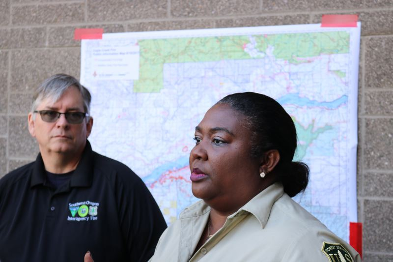 OUTLOOK PHOTO: ZANE SPARLING - Jim Whittington, left, and a U.S. Forest Service spokeswoman speak with reporters on Monday, Sept. 11, in Troutdale.