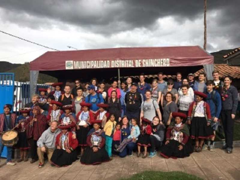 COURTESY OF GREG WILLIAMS - Members of the Wide Open Humanitarian dental team pose with villagers at one of their stops in Peru. King City dentist Greg Williams is sixth from the right in the back row.