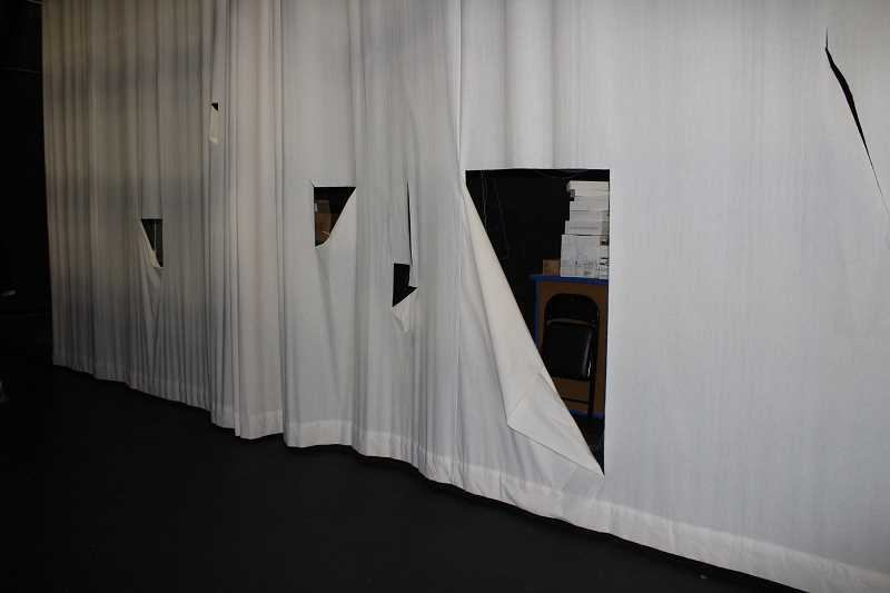 HOLLY SCHOLZ - Vandals sliced holes in the stage curtains at the Crook County High School auditorium, and the police investigation continues. The nearly $21,000 curtains were purchased with bond money two years ago.