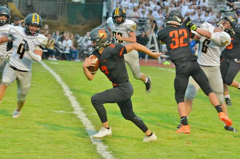 SPOTLIGHT PHOTO: JAKE MCNEAL - Seniors Jerad Toman (2), Tristan Miller (32) and the Indians can avenge last year's 24-21 loss at Cottage Grove on Friday in Scappoose.