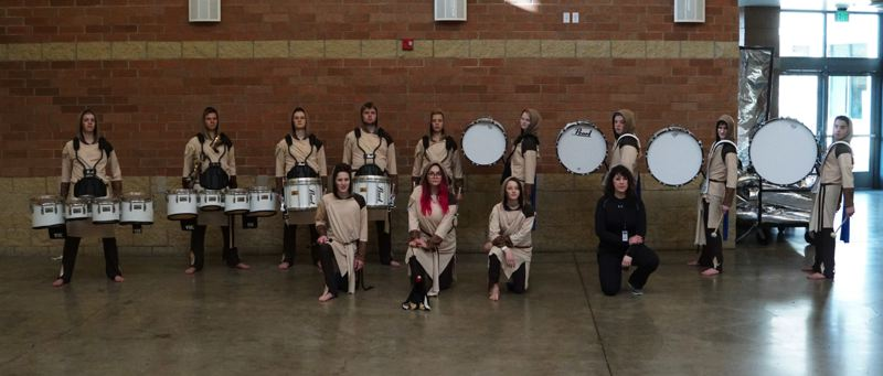 SUBMITTED PHOTO - Rene Ormae-Jarmer, RPHS drum-line director (below right), joins her students for a recent photo.