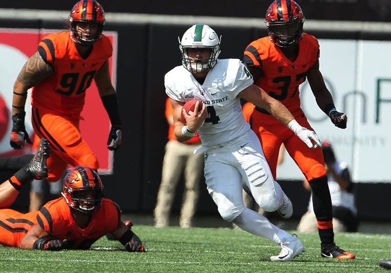 COURTESY: LARRY LAWSON - Portland State's Josh Kraght knifes through the Oregon State defense.
