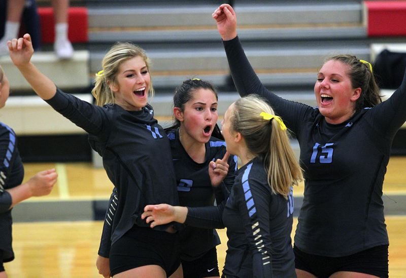 REVIEW PHOTO: MILES VANCE - Lakeridge's (from left) Deborah Brigman, Ashley Warmenhoven, Maicy Wear and Hannah Barry celebrate their team's 3-1 win over Lake Oswego at Lake Oswego High School on Monday.