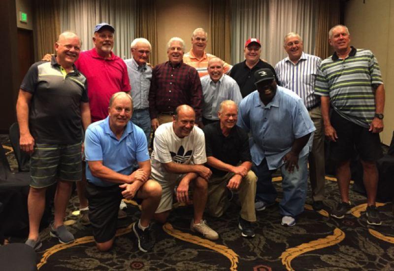 COURTESY: GARY BECK - Nebraska football coach Mike Riley (front row, second from left) huddles with former Corvallis High football teammates and then-Spartans coach Chuck Solberg (back row, third from left) before last week's Cornhuskers game against Oregon.