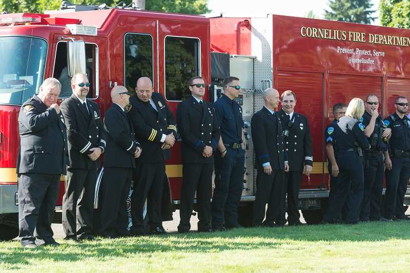 NEWS-TIMES PHOTO: CHRISTOPHER OERTELL - Public safety officers line up while waiting for the ceremony to begin.