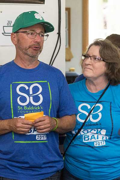 NEWS-TIMES PHOTO: CHRISTOPHER OERTELL - David Strickland and his wife Coral talk about what the St. Baldrick's event means to their family.