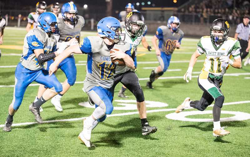LON AUSTIN/CENTRAL OREGONIAN - Crook County running back Kyle Brady breaks loose for a big run. Brady carried the ball 12 times for 78 yards in the Cowboys' 21-0 loss to the Sweet Home Huskies.