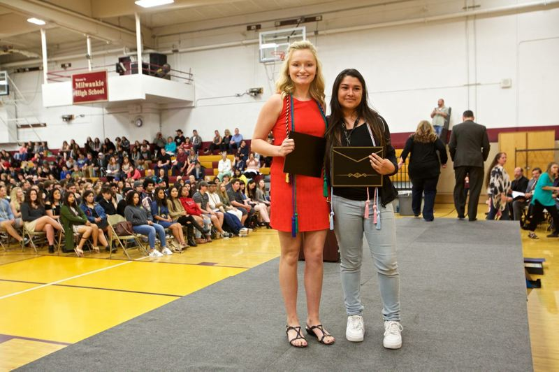 SUBMITTED PHOTO - 2017 Milwaukie High School graduates Aimee Copenhaver, left, and Rocio Sanchez-Cortez display their certificates as winners of scholarships given by the Mustang-Born Scholarship Foundation.