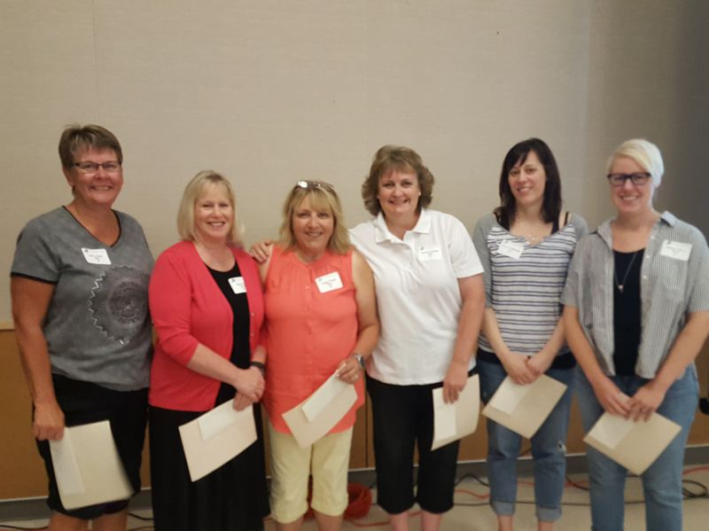 PHOTO COURTESY: LESLIE ROBINETTE - Nancy West, Ellen Peck, Peggy Powell, Shannon Bohrer, Rebecca Chitkowski and Celeste Pellicci received cash awards at Gladstone Schools all-employee event to kick off the new school year.
