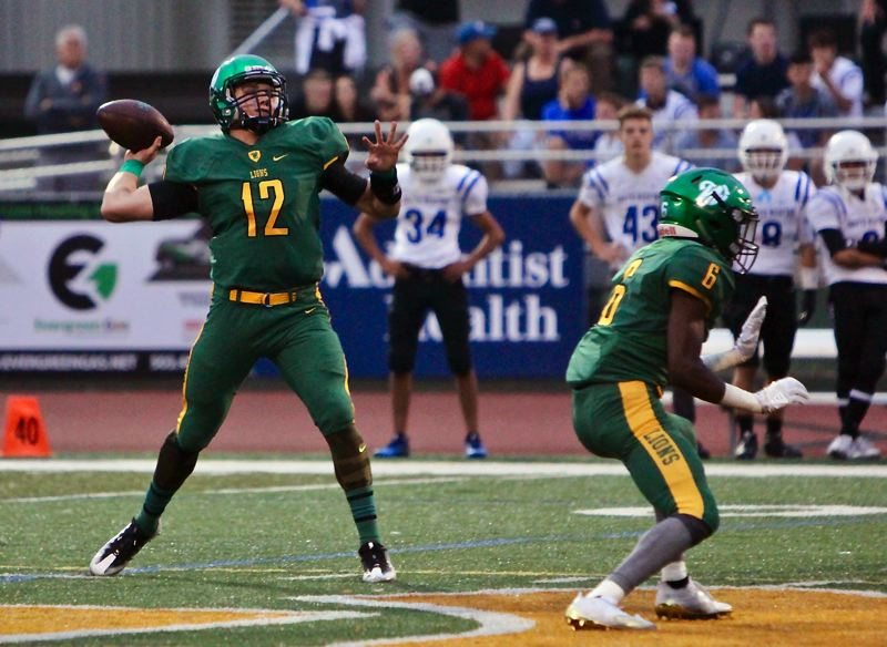 COURTESY PHOTO: FAITH VARGA - West Linn quarterback Ethan Long gets ready to throw a pass during his team's 21-14 win over South Medford at West Linn High School on Friday.