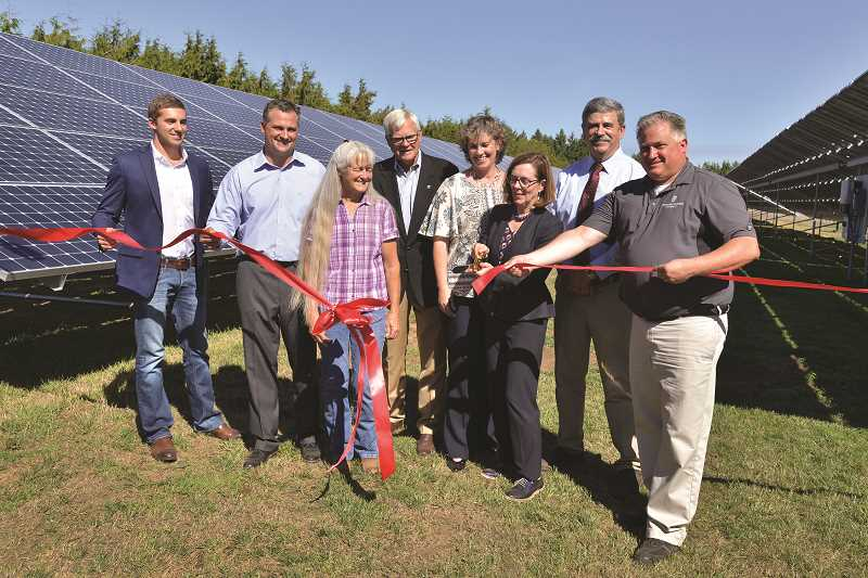 SUBMITTED PHOTO: GREG LEO - Brown cuts the ribbon for the solar array, which offsets all of the plant's energy use. Pictured from right to left: Jordan Sinn of Earthlight Technologies; Shaun George; Polly Owen, director of the Oregon Hazelnut Commission; Marion County Commissioner Kevin Cameron; Barb Yates, Fererro representative; Gov. Brown; Rep. Rick Lewis; and Larry George.