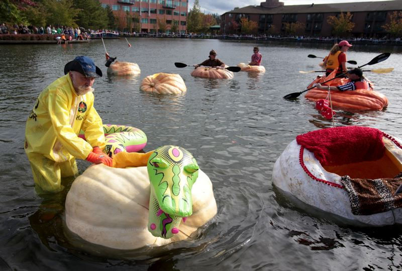 FILE - Richard Raymond prepares his pumpkin boat for the 2014 West Coast Giant Pumpkin Regatta in Tualatin.