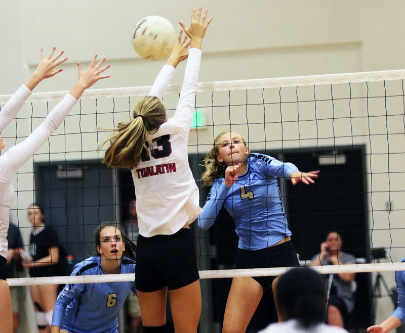 TIMES PHOTO: DAN BROOD - Lakeridge sophomore Holland Jackson hits a shot past Tualatin freshman Kylie Zralka during their Sept. 7 match at Tualatin High School.
