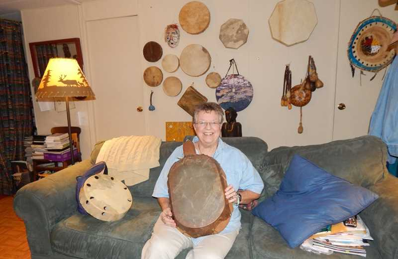 BARBARA SHERMAN - Connie Hill pretty much lives in a drumming world with drums all around her Eldorado home, and she is holding a special one given to her by a friend that is a turtle, her spirit animal.