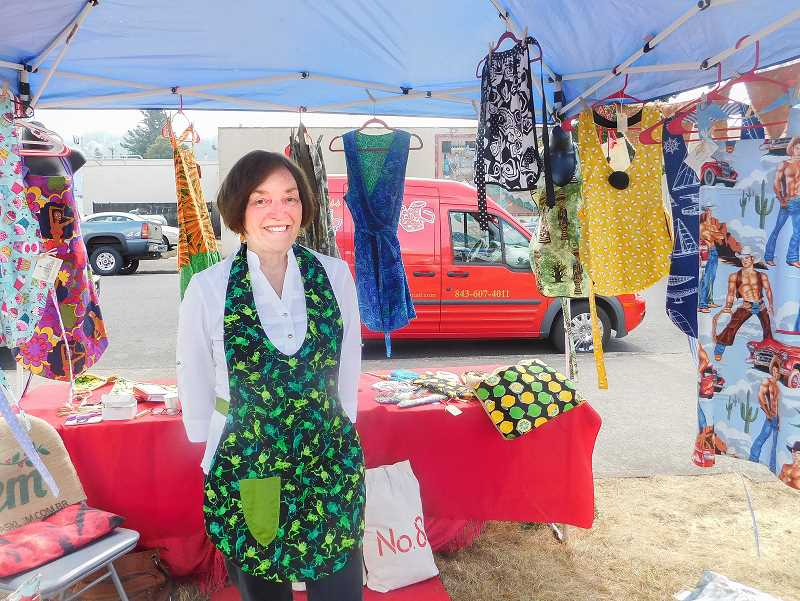 ESTACADA NEWS PHOTO: EMILY LINDSTRAND - Peggy Price of Magnolia Designs said she enjoyed the cheerful atmosphere of Estacadas community trade fair last weekend. Price, a resident of Boring, joined the Estacada Chamber of Commerce specifically so she could participate in the event.
