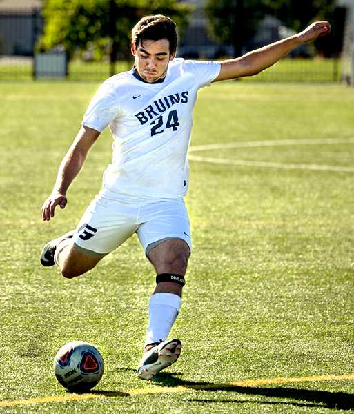 PHOTO COURTESY OF GABE CLARK - George Fox University defender Gabe Ramirez launches a ball from just outside the box during the Bruins' 3-2 home win over Northwest Christian on Sunday. Ramirez scored in the 75th minute to tie the game.