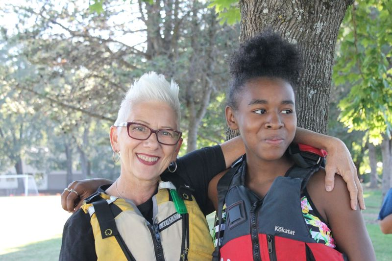 PAMPLIN MEDIA GROUP: LYNDSEY HEWITT - Twelve-year-old RaNasia Duckett hangs with her Big Sister, Deborah Eckel.