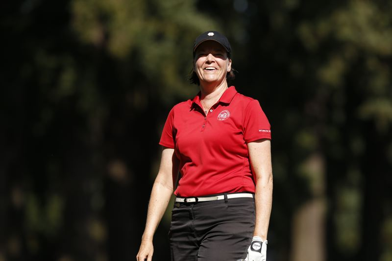 COPYRIGHT USGA/STEVEN GIBBONS - Tara Fleming smiles after a putt during one of her matches Tuesday in the U.S. Senior Women's Amateur at Waverley Country Club.