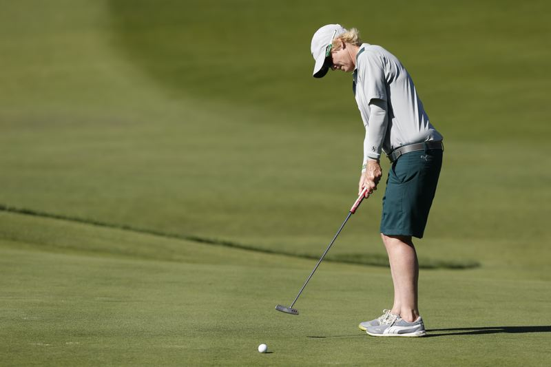 COPYRIGHT USGA/STEVEN GIBBONS - Canada's Terrill Samuel putts during a match Tuesday in the U.S. Senior Women's Amateur Championship.