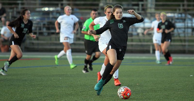 TIDINGS PHOTO: MILES VANCE - West Linn's Jill Brody races upfield during her team's 3-2 loss to Central Catholic at Delta Park's Strasser Field on Tuesday.