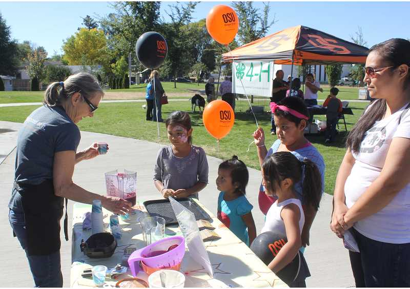 PIONEER FILE PHOTO - Kids line up for a fresh fruit smoothie at one of last year's booths at OSU Extension Community Day.