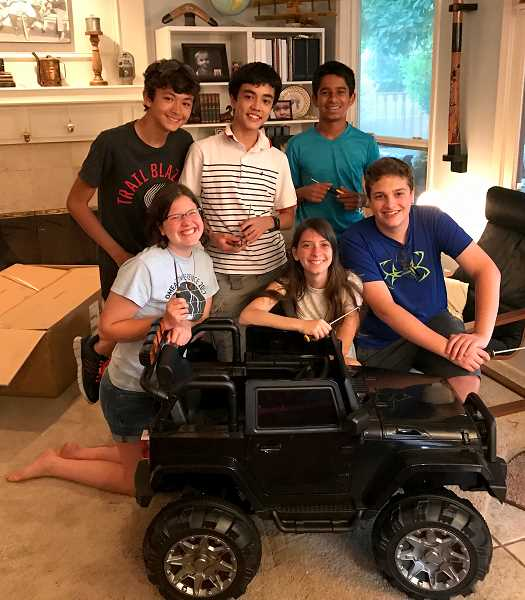 SUBMITTED PHOTO - (Front, left to right) Sohma Cox, Lui Blomberg, Sarthak Kadam, (bottom, left to right) Kyra Allen, Lyv Neal and Michael Culp of team Urianium 235 unpacking Noahs electric car.