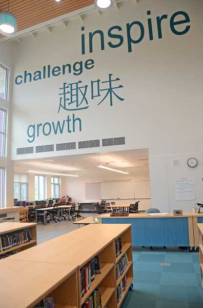 SPOKESMAN PHOTO: VERN UYETAKE - The blue words on the wall are shown in multiple languages to honor the language programs the school offers.