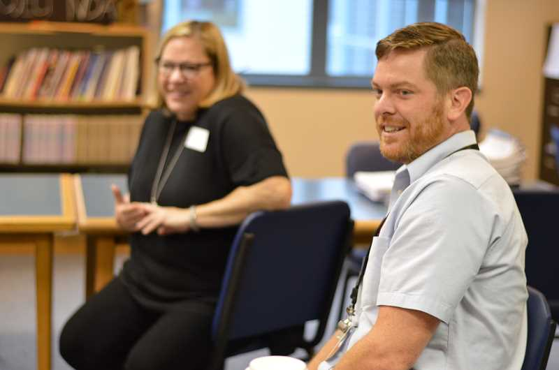 SPOKESMAN PHOTO: CLARA HOWELL  - Zach Deets (right), the school counselor, and Principal Lindy Sprouls (left) sat front and center to welcome a handful of kindergarten parents to the new school year.