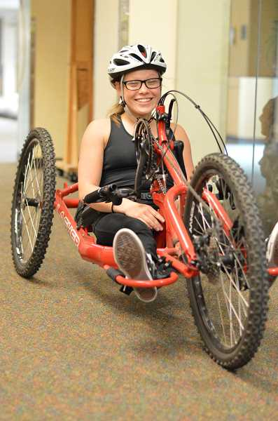 SPOKESMAN PHOTO: CLARA HOWELL - Junior Kayla Bolnick, who competes in her hand chair for cross country, rides around in the hallways of WHS.