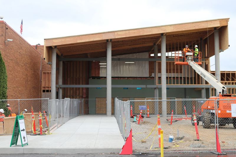 OUTLOOK PHOTO: JOSH KULLA - The new entrance to Reynolds High School is shaping up. When it's done, it will be enclosed in glass and will create a light-filled spot for students.