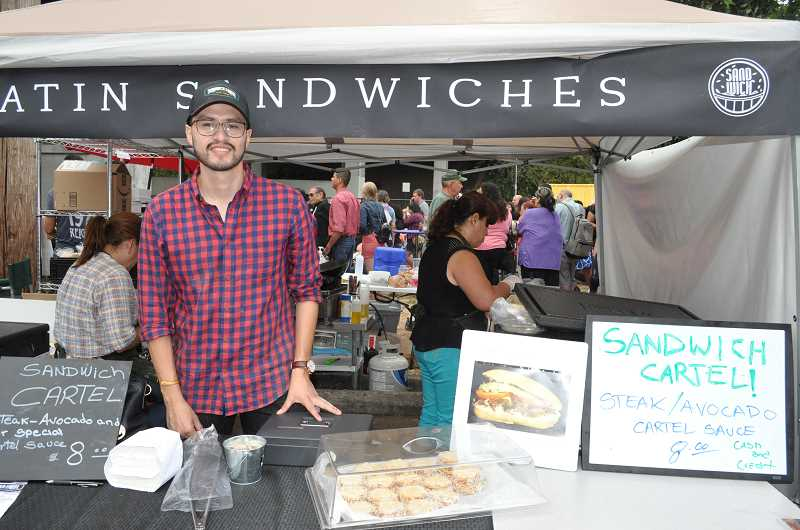 TIMES PHOTO: BLAIR STENVICK - Norbeth Marticorena, co-owner of Sandwich Cartel, served steak and avocado sandwiches at the Tigard Latino Festival.