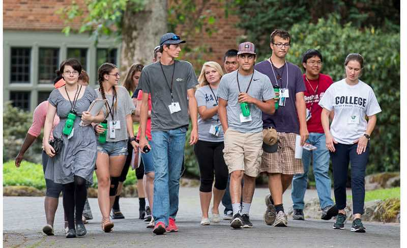 TIMES FILE PHOTO - A group of high school students tour Lewis & Clark, which has a test-optional admissions policy.