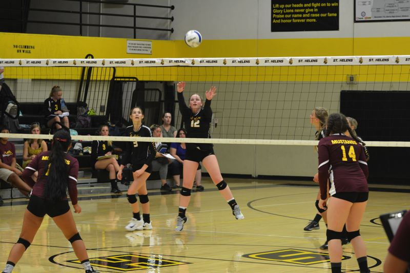 SPOTLIGHT PHOTO: JAKE MCNEAL - Lions senior Kenna Reinholdt (12) pushes a shot into Milwaukie's side of the net.