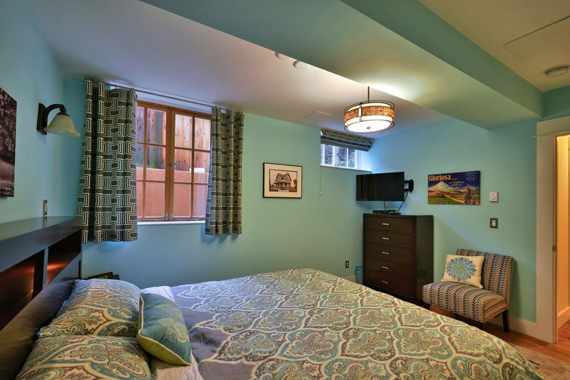 PHOTO BY JIM HEUER, COURTESY KOL PETERSON  - This is the bedroom in a recent basement conversion for an ADU in Northeast Portland.