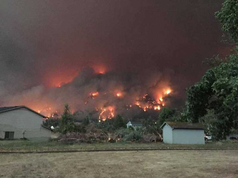 PHOTO COURTESY OF LAYLA MCLEAN - The Eagle Creek Fire covers a hillside in this photo taken from the McLean family's property in Cascade Locks. The family made the decision on Sept. 5 to evacuate.