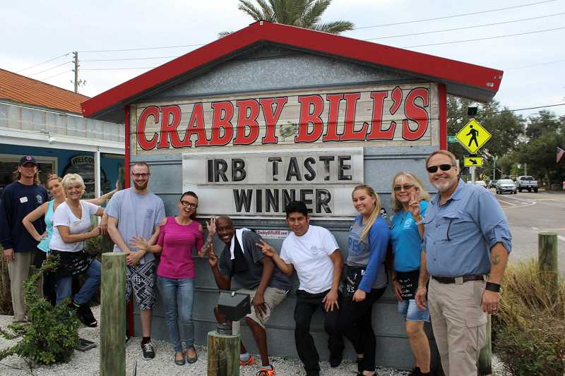 PHOTO COURTESY OF MIA LODER CORRALES - The Loder family and employees of the Crabby Bill's restaurant pose outside their business in Indian Rocks Beach, Florida. As of Wednesday, the family still didn't know how much damage the eatery sustained when Hurricane Irma came ashore.