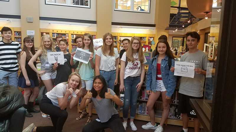 SUBMITTED PHOTO: SARAH HANSEN - Riverdale High School's freshman class started school ahead of other students to partake in a special day filled with information and activities designed to acquaint them with the school and each other. One fun activity was an 'Escape Room' simulation in the library.'Every group had to work as a team and communicate well in order to find the clues and figure out lock combinations,' says Librarian/Media Specialist Sarah Hansen. 'And each team was successful in solving the puzzles and opening all the locks to escape!'