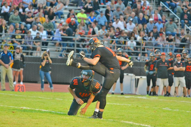 SPOTLIGHT PHOTO: JAKE MCNEAL - Junior wide receiver Connor McNabb (44) and senior wide receiver/kicker Benji Davidson (17) help the Indians to the most points in all of Class 4A.