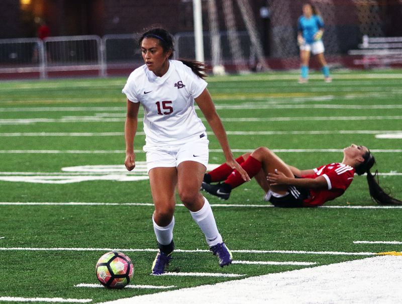 DAN BROOD - Sherwood junior Madi Pastores heads upfield with the ball during Tuesday's match with Camas.