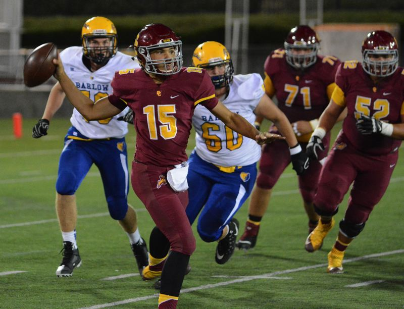 OUTLOOK PHOTO: DAVID BALL - Central Catholic QB Cade Knighton eludes pressure and gets off a throw during the Rams 41-21 win over Barlow on Friday night.