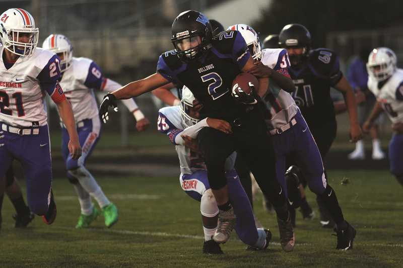 PHIL HAWKINS - Woodburn tailback Luis Guerrero led all players with 93 rushing yards as the Bulldogs amassed 252 yards on the ground in a 24-13 victory over Benson on Friday.